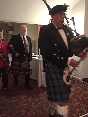 Piper Art Tenney pipes in the Honor Clan at the NEFL Highland Game Sponsors Dinner.